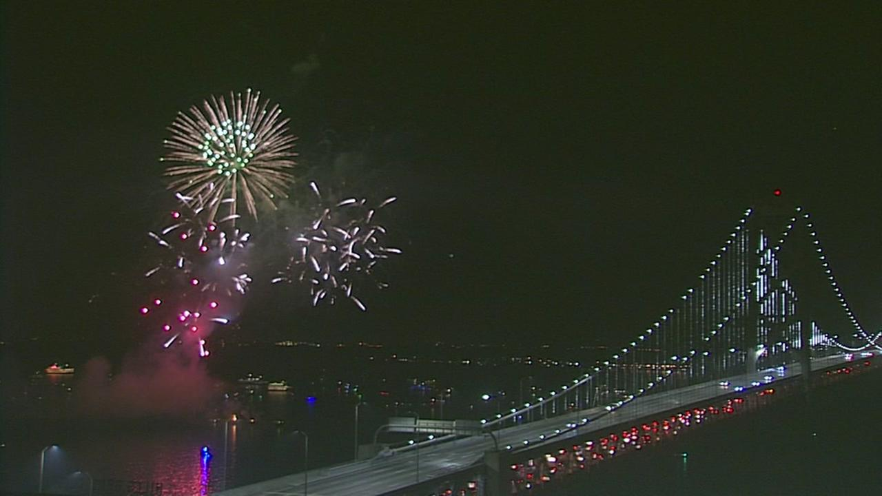 New Years fireworks show ignite the sky over the San Francisco Bay.