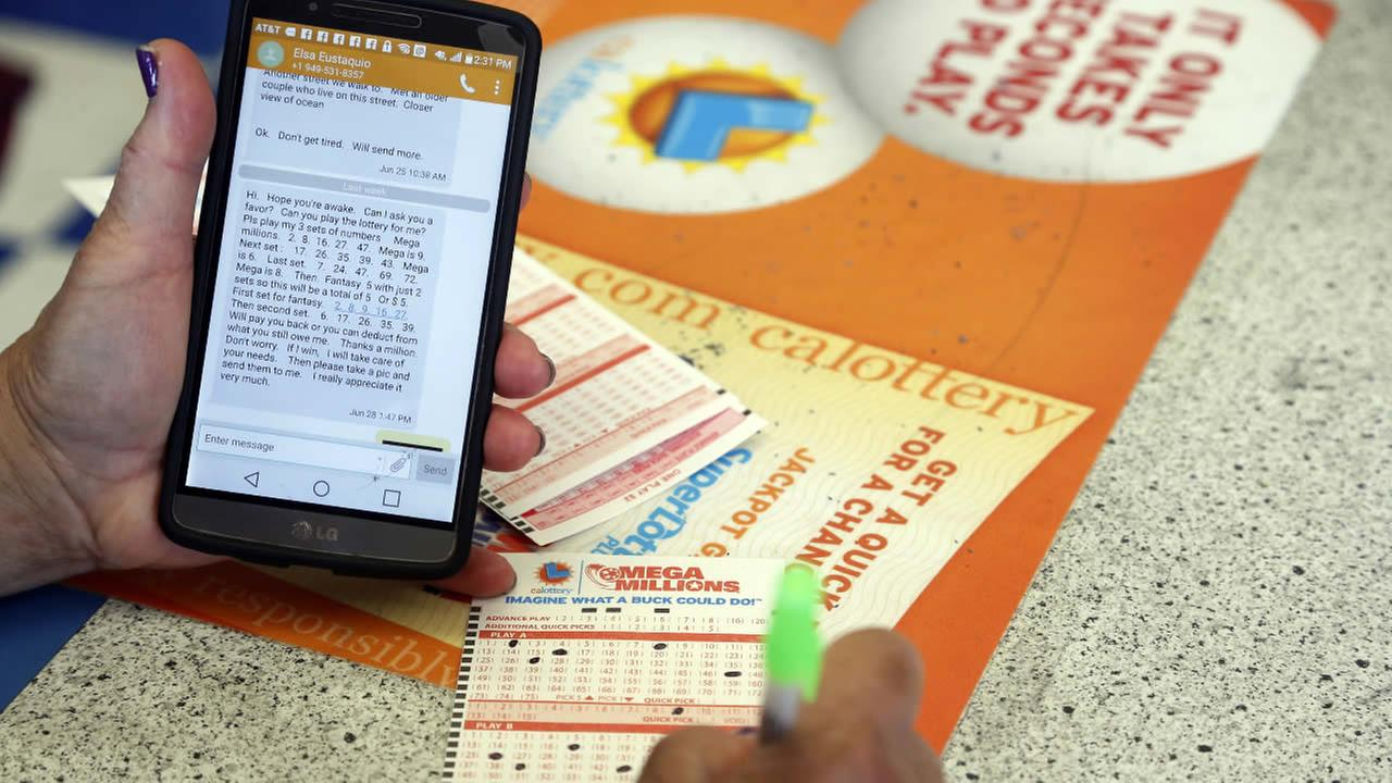 A player fills out lottery slips from texted instructions at Bluebird Liquors in Hawthorne, Calif., Friday afternoon, July 8, 2016. (AP Photo/Nick Ut)