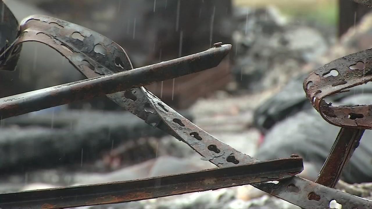 Raindrops fall on a fire-damaged lot in Santa Rosa, Californias Coffey Park neighborhood on Monday, Jan. 8, 2018.