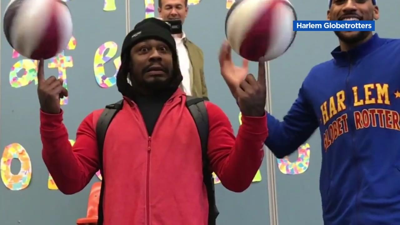 Marshawn Lynch is amazed by the Harlem Globetrotters in Oakland, Calif. on Thursday, Jan. 11, 2018.