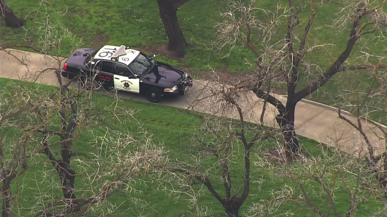 A CHP vehicle is seen on a golf course searching for a suspect in Sunnyvale, Calif. on Monday, Jan. 15, 2018.