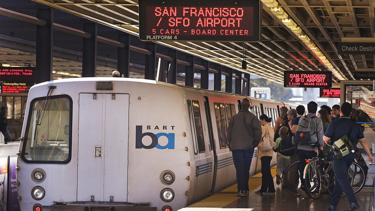 BART passengers get ready to board a San Francisco-bound train.