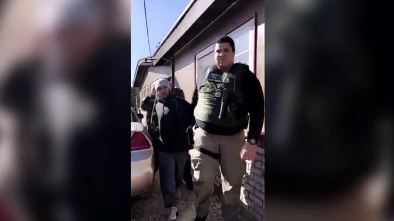 ICE agents are seen arresting a man in Napa, Calif. on Sunday, Feb. 25, 2018.