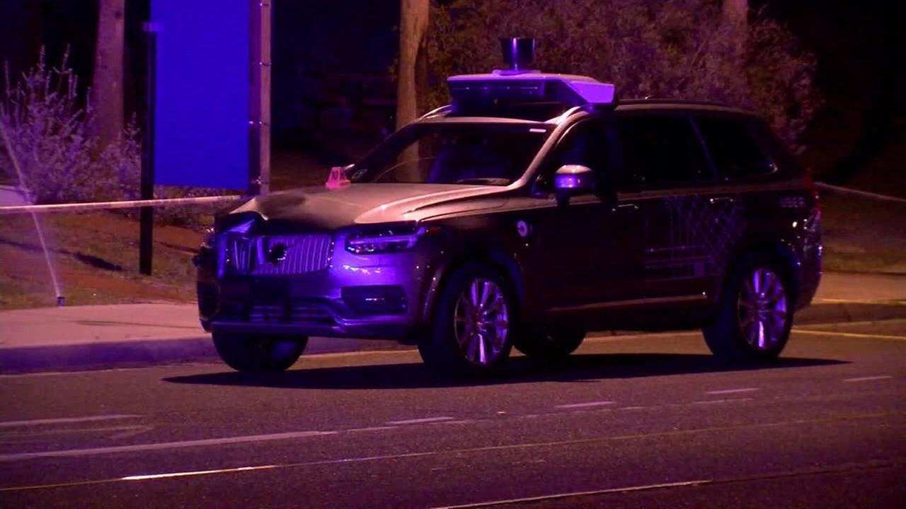 A self-driving Uber vehicle is seen after a fatal crash in Arizona on Monday, March 19, 2018.