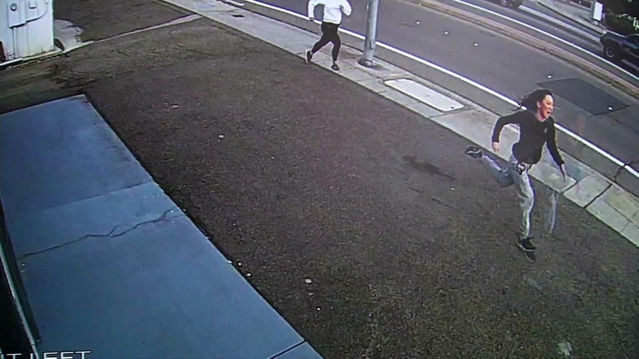 This still image shows Hannie Dong and Misty Welborn chasing after a laptop thief in Castro Valley, Calif.