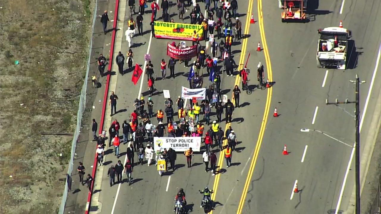 Union members at the Port of Oakland are seen taking part in a May Day march on Tuesday, May 1, 2018.