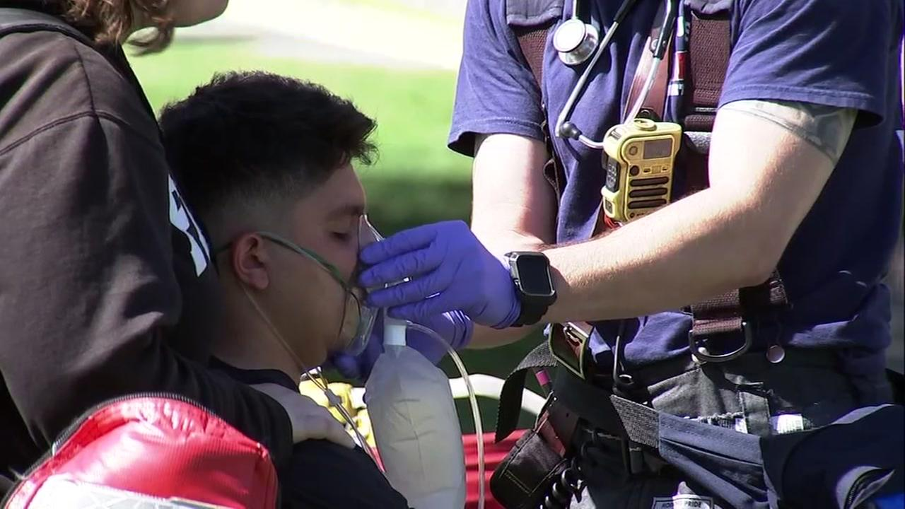 A student is tended to in San Jose, Calif. after a chemical exposure on Wednesday, May 9, 2018.