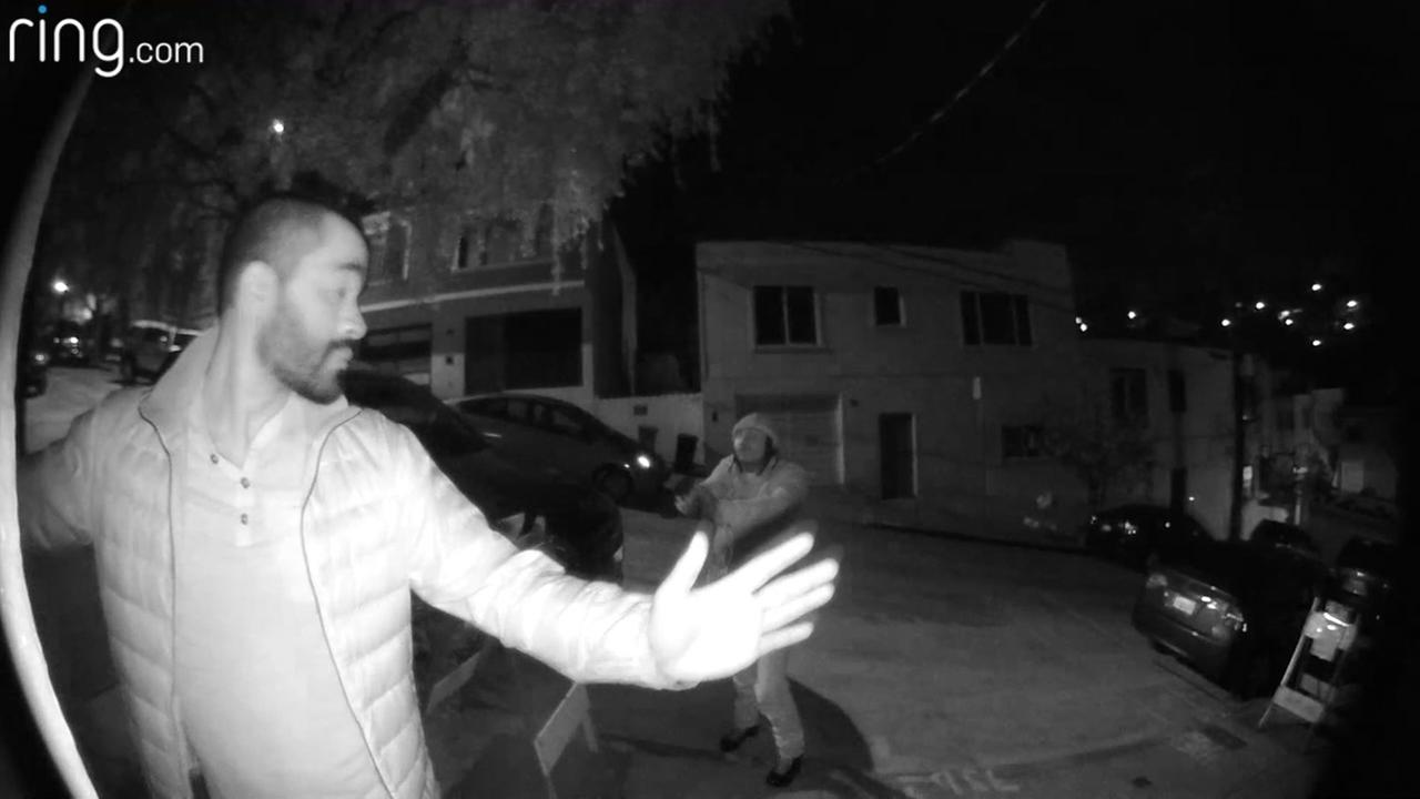 A man is seen being held up in front of a home in San Francisco in this undated image.