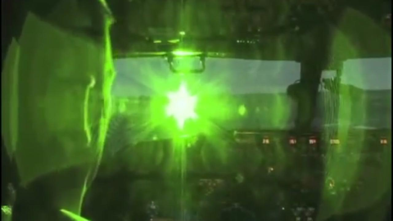 A laser strike is seen inside the cockpit of an airplane in this undated image.