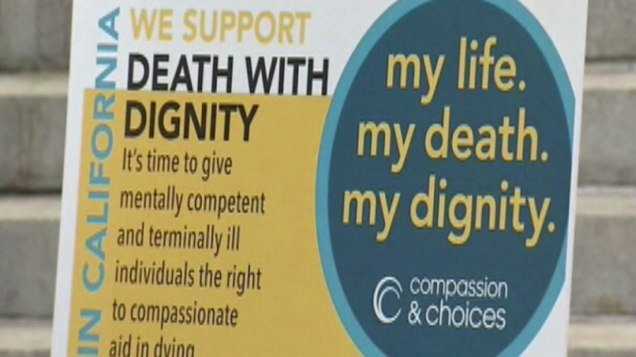 A sign advocating for the right to die appears in this undated image.