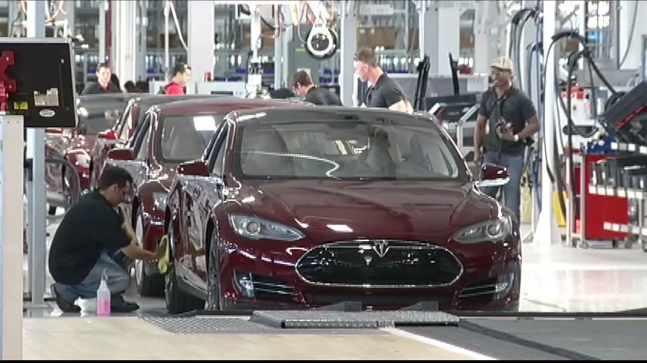 Tesla Model 3 vehicles appear in this undated image.