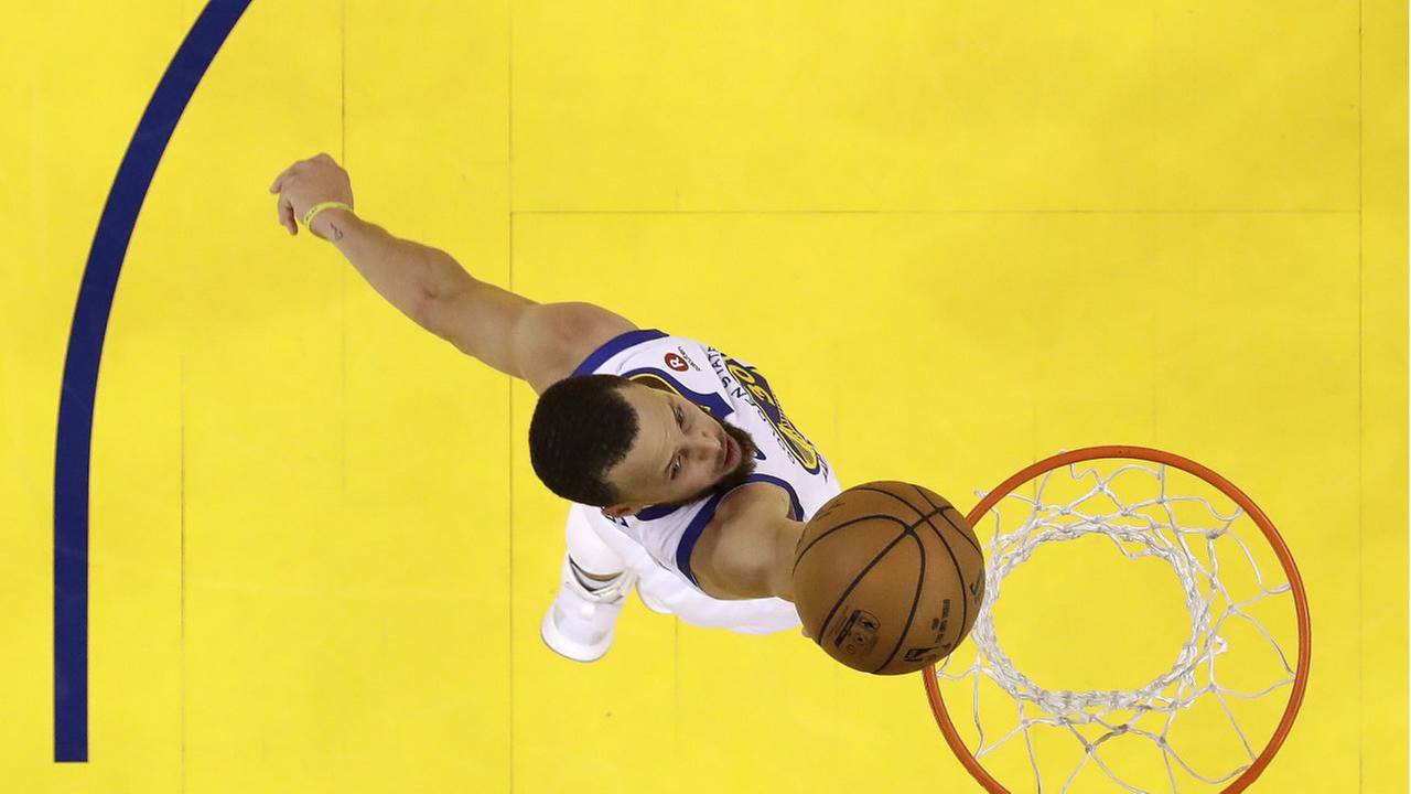 Warriors Stephen Curry drives to the basket against the Rockets during Game 6 of the NBA basketball Western Conference Finals Saturday, May 26, 2018, in Oakland, Calif. (AP Photo)