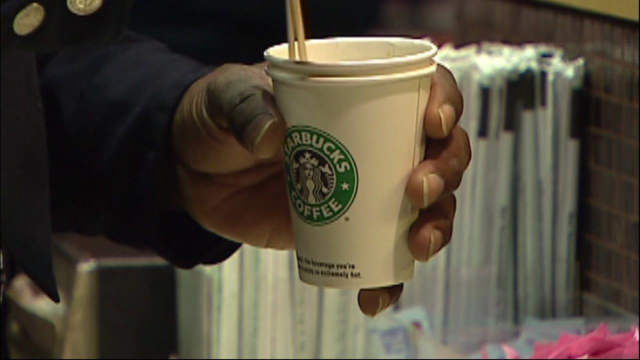 A man stirs a Starbucks drink in this undated image.