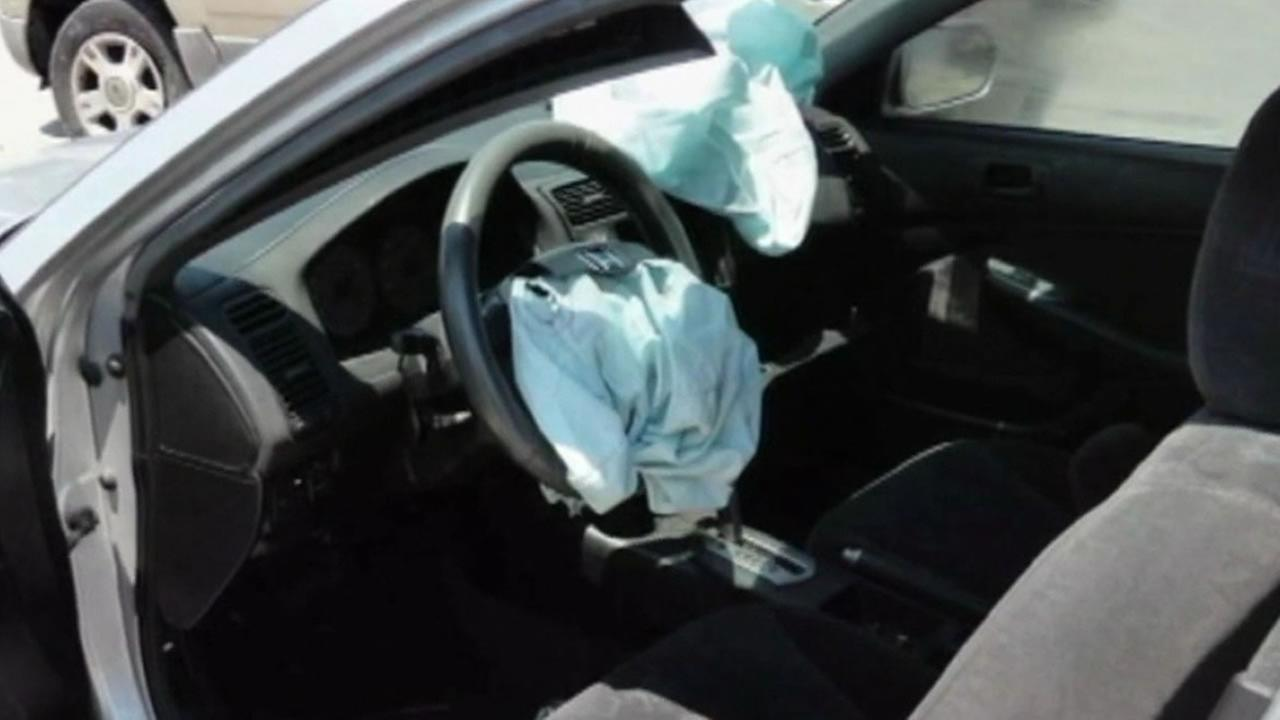 airbags deployed inside of a car