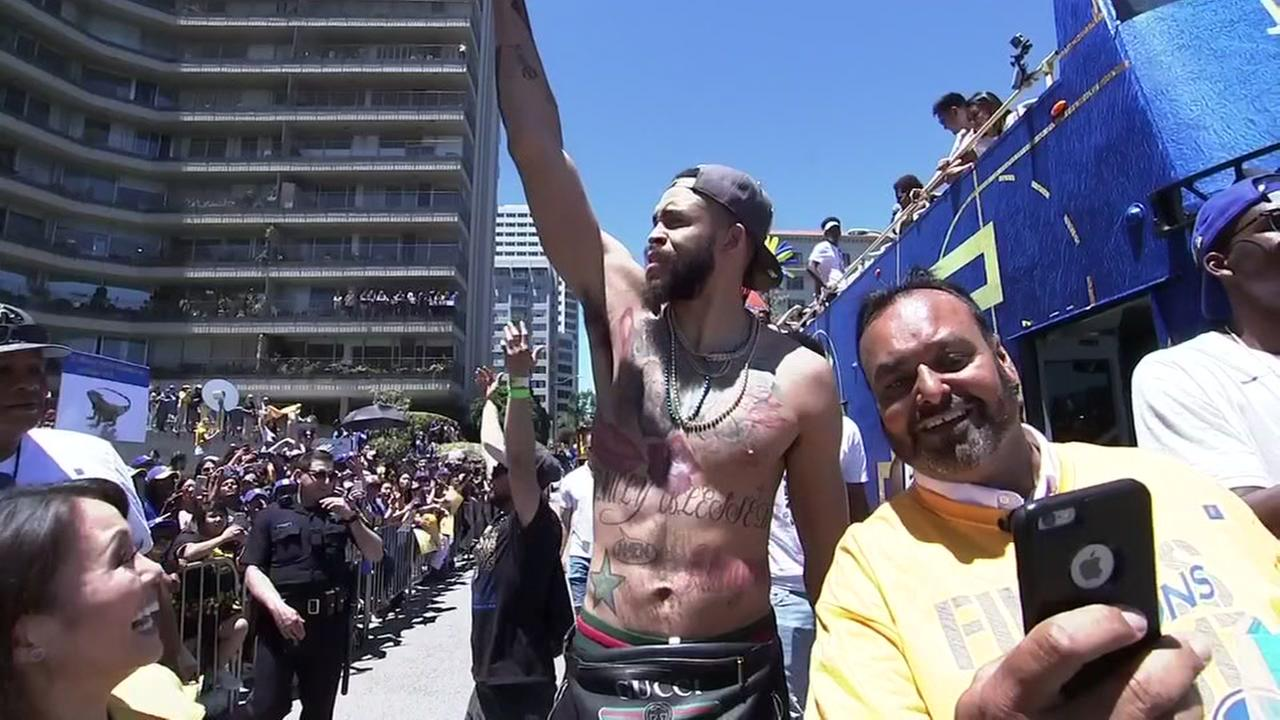 JaVale McGee celebrates with fans at the Warriors victory parade in Oakland, Calif. on Tuesday, June 12, 2018.