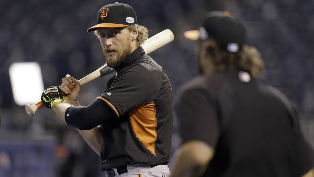 San Francisco Giants Hunter Pence, left, and teammate Michael Morse, right, prepare for batting practice during a workout Monday, Oct. 27, 2014. (AP Photo/Jeff Roberson)