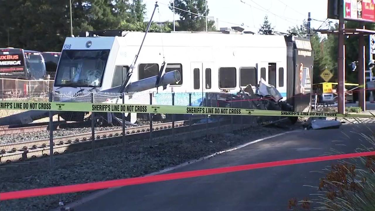 A crash between a car and a VTA lightrail vehicle is seen on Sunday, July 8, 2018.