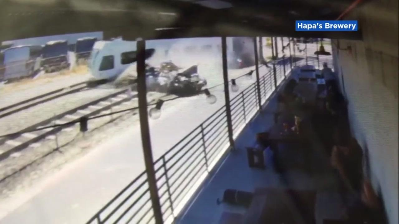 Surveillance video captured a horrific collision between a VTA train and a car in San Jose, Calif. on Sunday, July 8, 2018.
