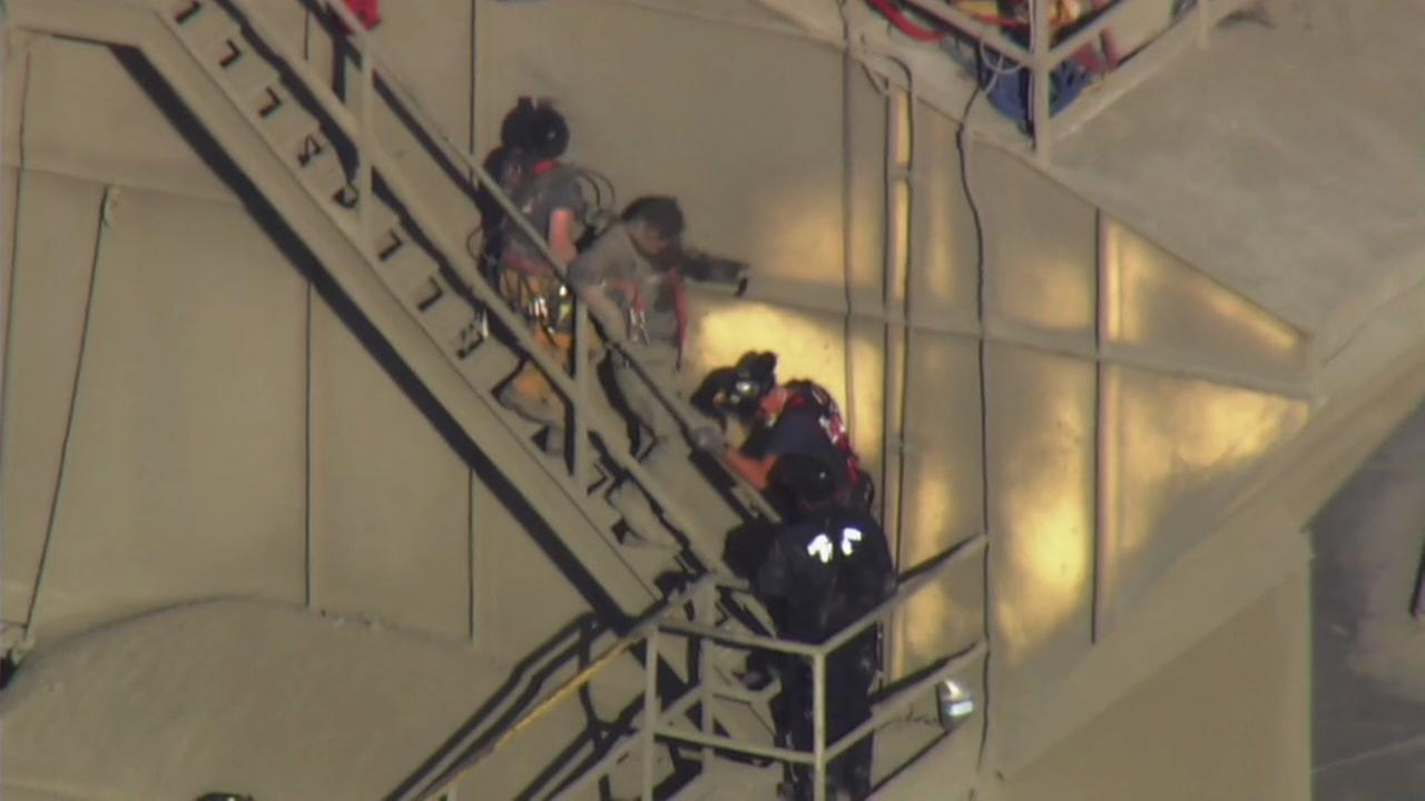 A man walks down the stairs in Union City after rescued from being stuck in a cement mixer on Thursday, July 12, 2018.