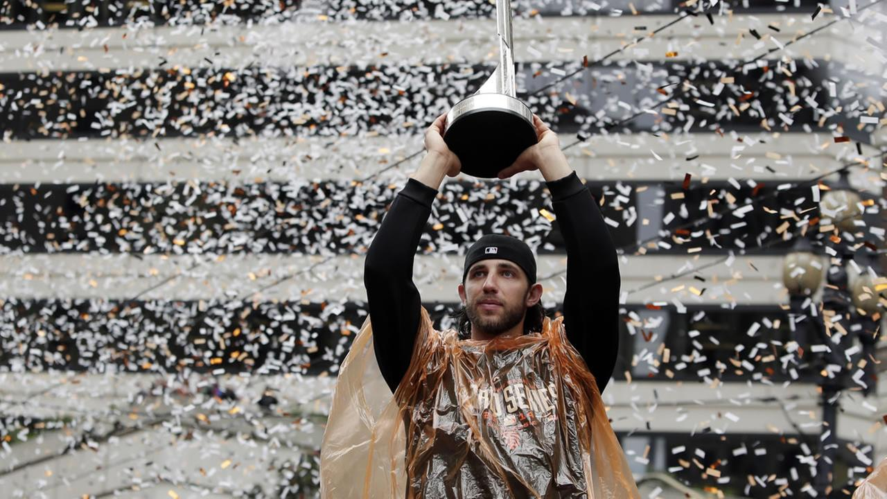 Madison Bumgarner holding a MVP trophy