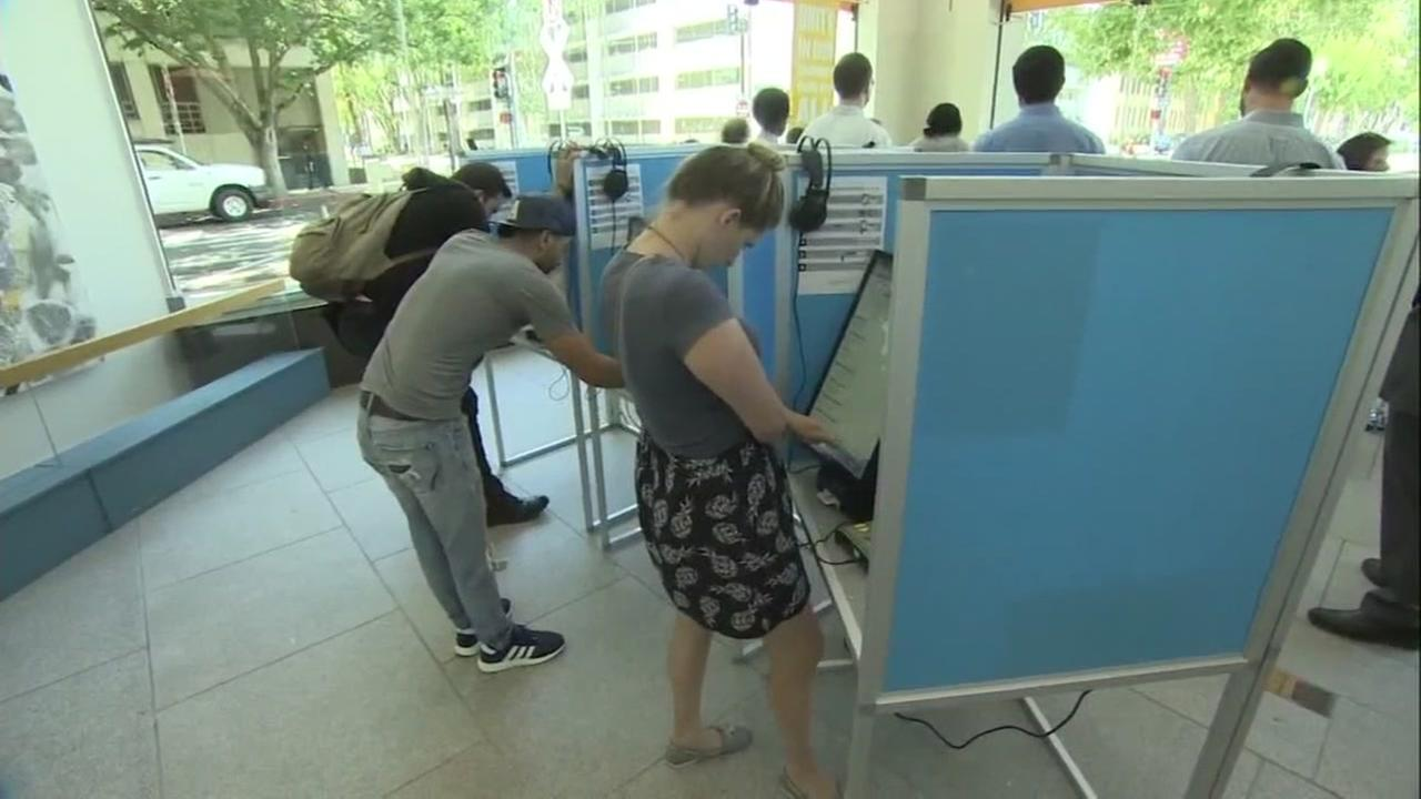 People are seen voting in this undated image.