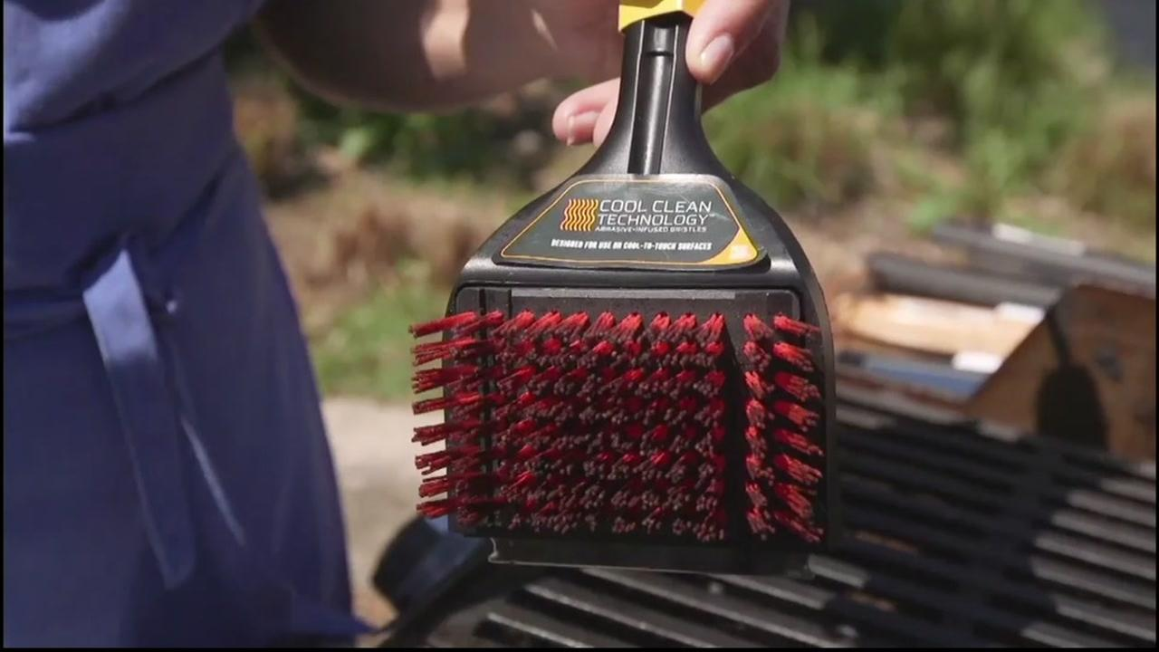 This is an undated image of a grill-cleaning brush.
