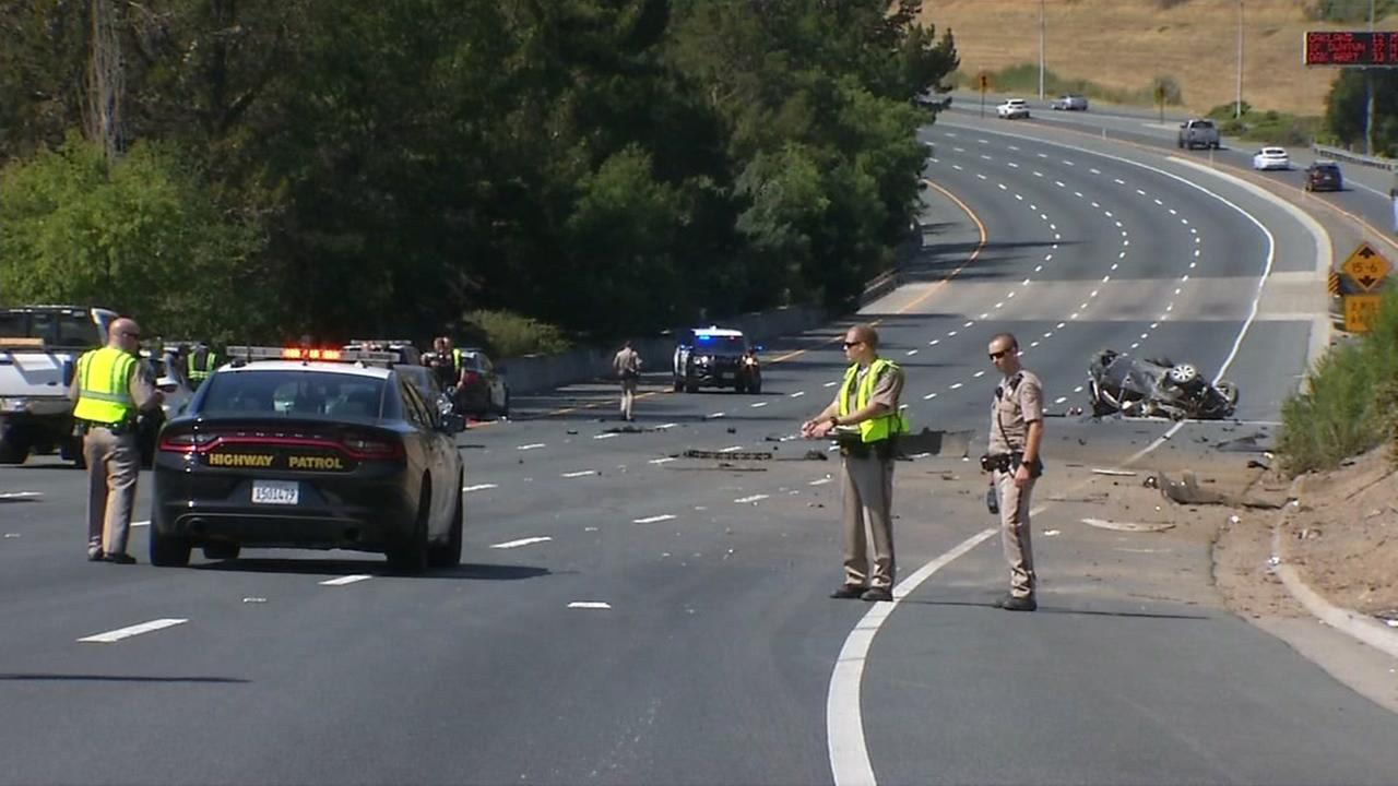 CHP officers are seen after a deadly crash in Orinda, Calif. on Saturday, July 21, 2018.