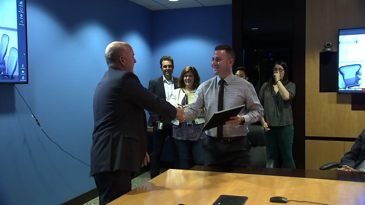 ABC7 President Tom Cibrowski (left) is seen handing an award to Sports Producer Casey Pratt (right) in San Francisco on Monday, July 30, 2018.