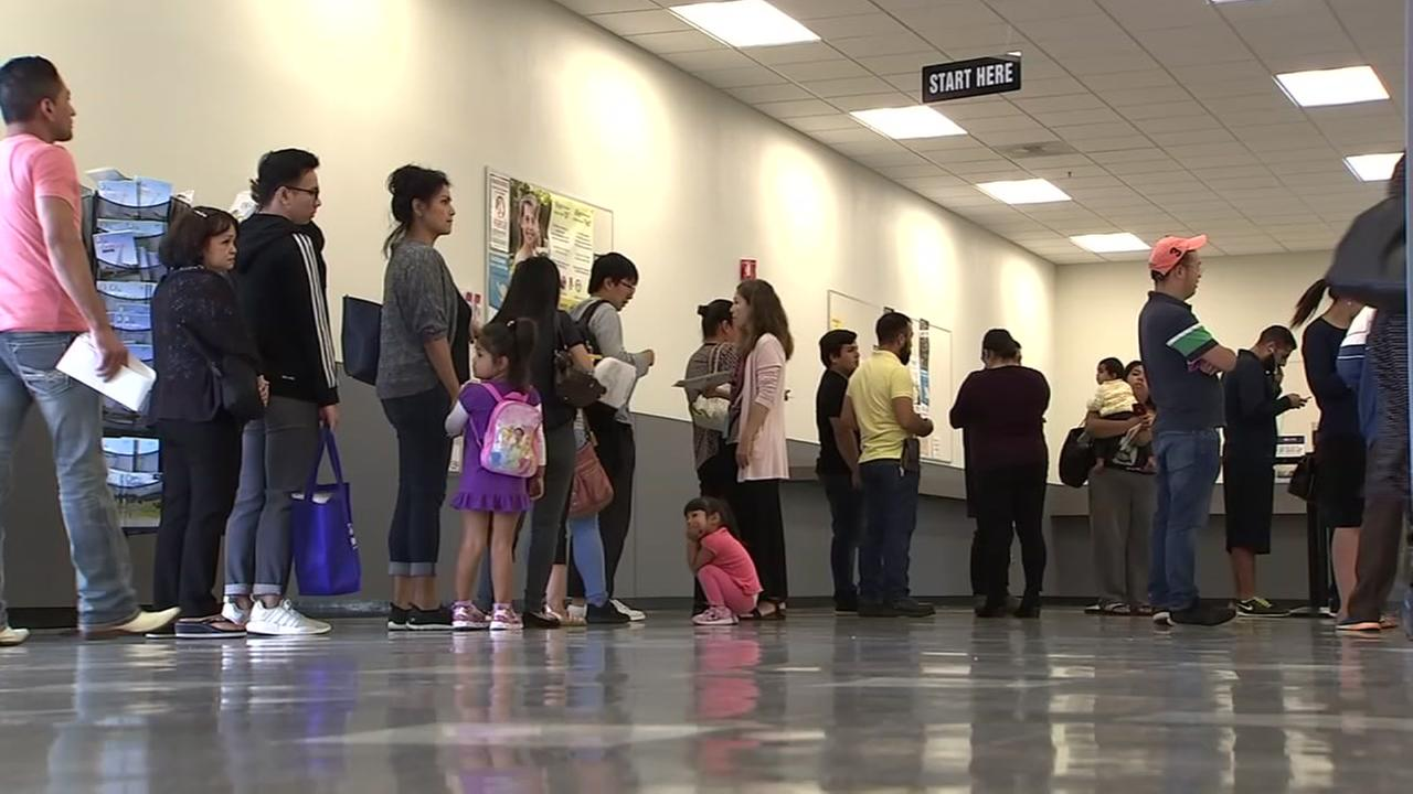 Dozens of people wait in line at a DMV in the Bay Area on Wednesday, Aug. 22, 2018.