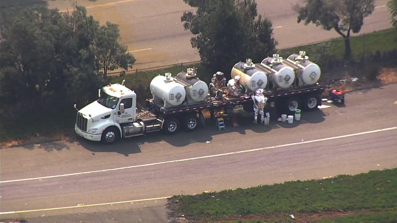 A hazmat crew works to neutralize acid spilled from a truck on I-880 in Hayward, Calif. on Friday, August 24, 2018.
