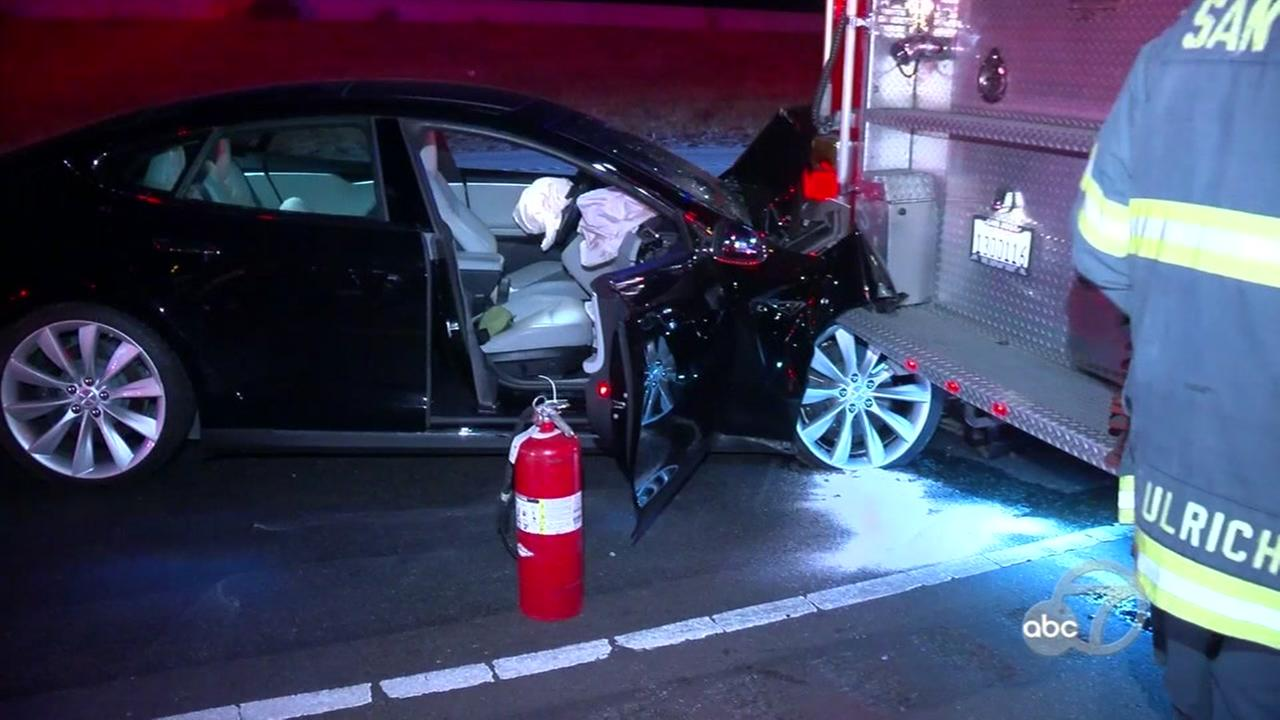 A Tesla is seen after crashing into a firetruck in San Jose, Calif. on Saturday, August 25, 2018.