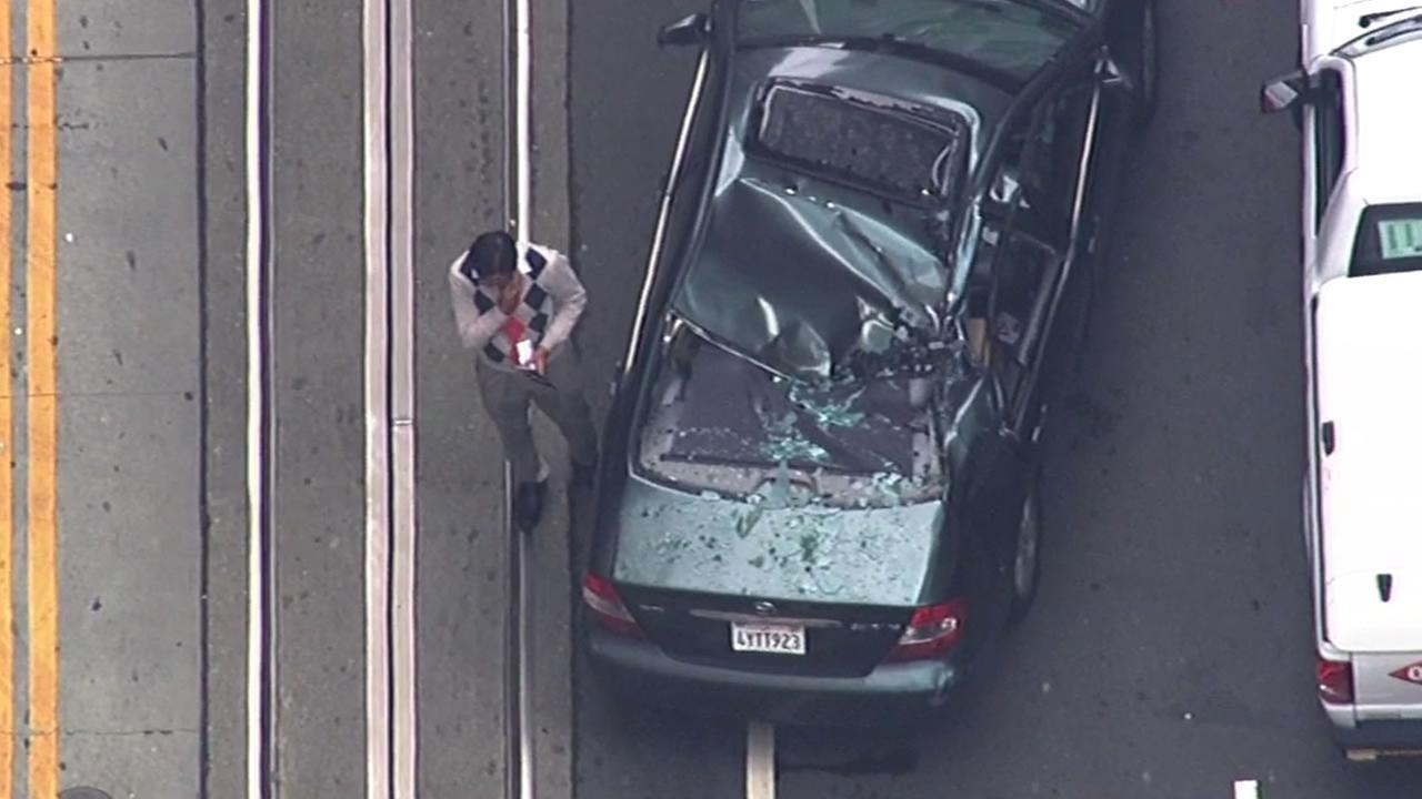 Mohammad Al Cozai escaped being injured when a window washer fell from a San Francisco Financial District building onto his car Friday.