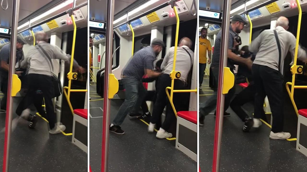 A fight appears on Muni in San Francisco on Aug. 31, 2018.
