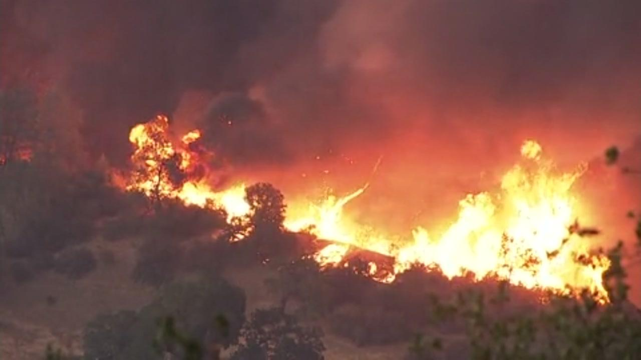 Flames from the Snell Fire are seen on a ridge in Napa County, Calif. on Saturday, September 8, 2018.