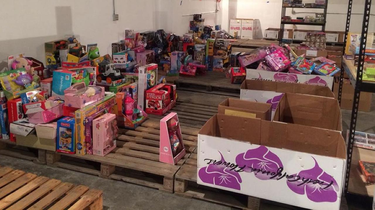 A Toys for Tots collection box is half full