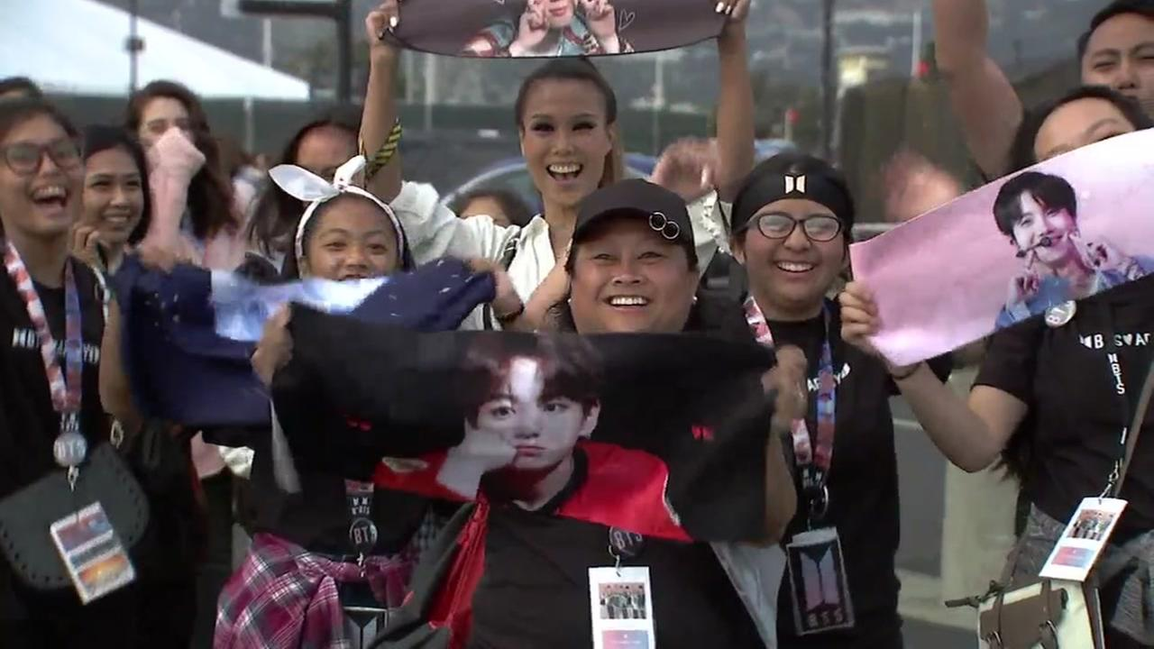 Fans of the K-Pop band BTS are seen outside Oracle Arena in Oakland, Calif. on Wednesday, September 12, 2018.