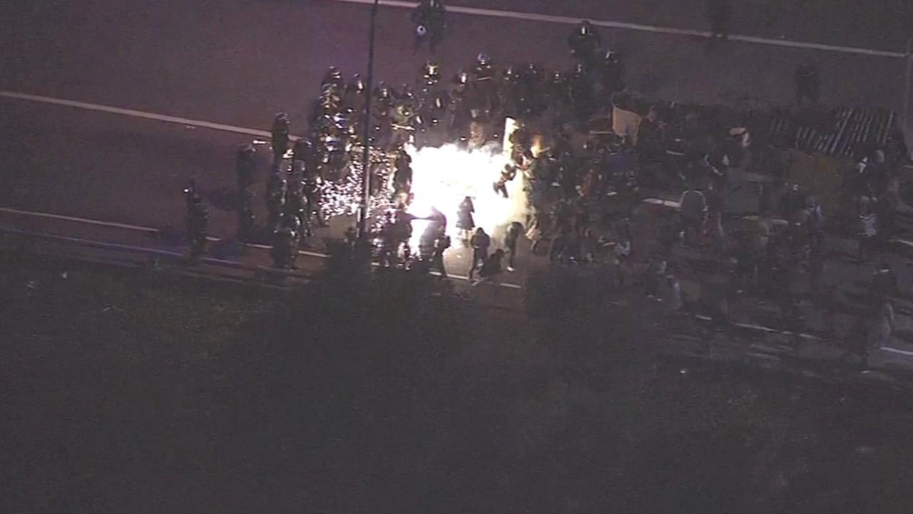 CHP release tear gas after demonstrators block Highway 24 in Oakland
