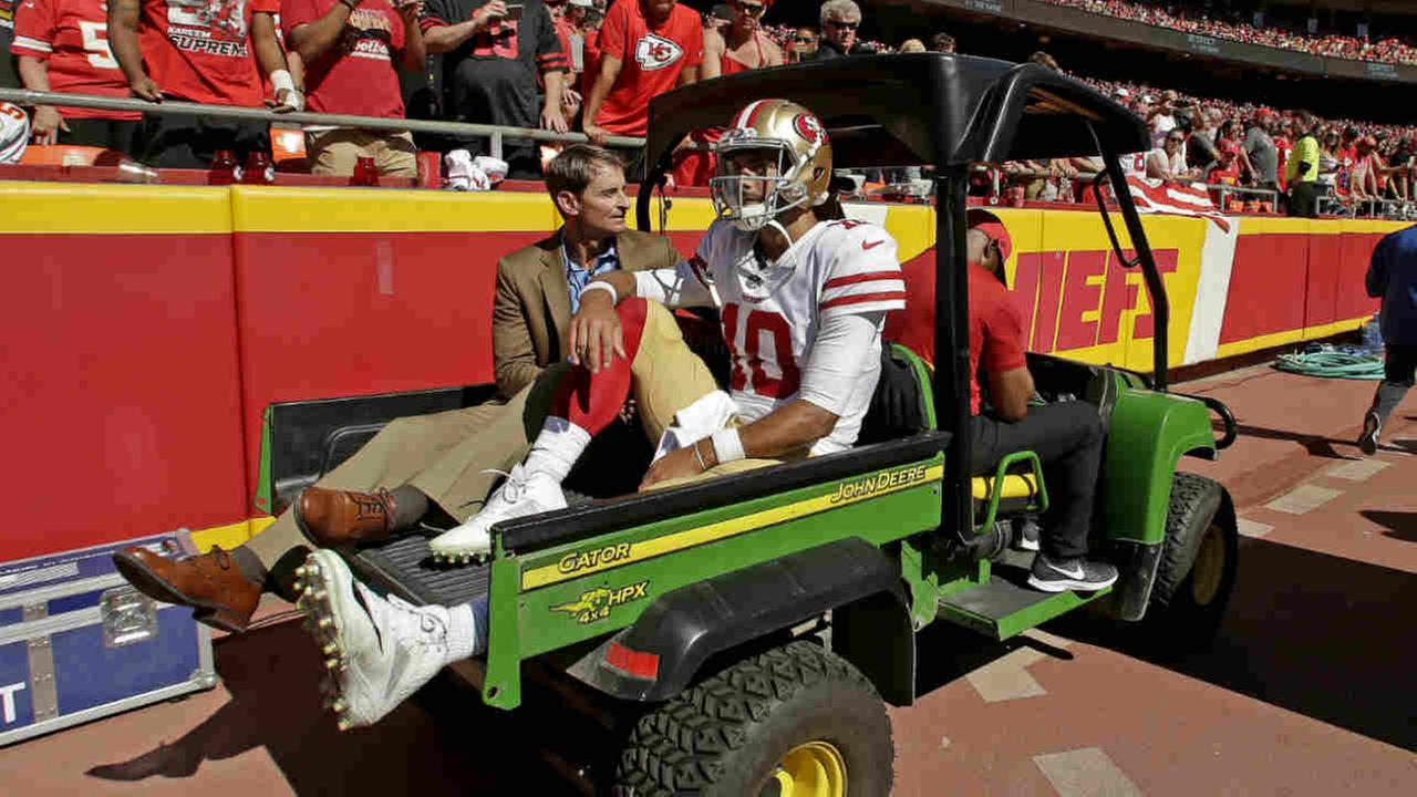 San Francisco 49ers quarterback Jimmy Garoppolo (10) is carted off the field after being injured in game against the Chiefs, Sunday, Sept. 23, 2018, in Kansas City, Mo.