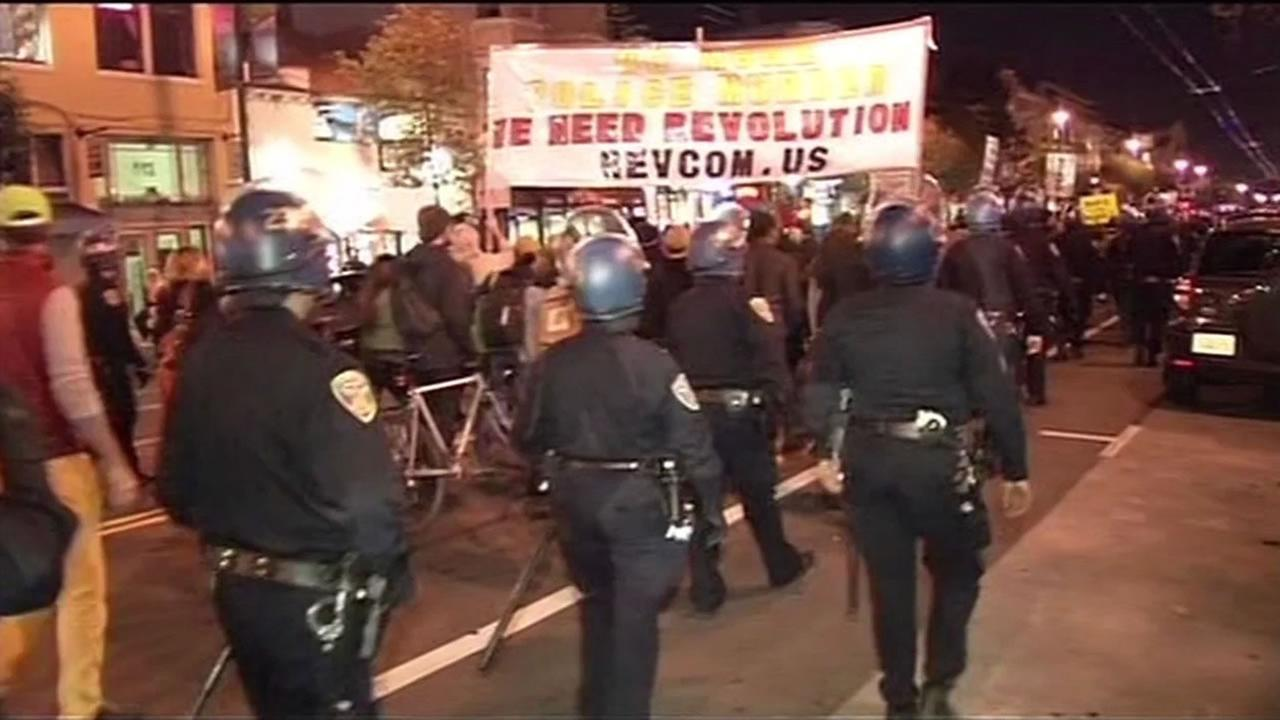 San Francisco police walk alongside protesters in one of many protests over the Michael Brown and Eric Garner rulings.