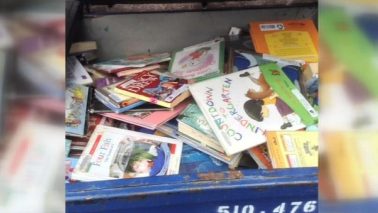 books outside a Fremont library in the trash