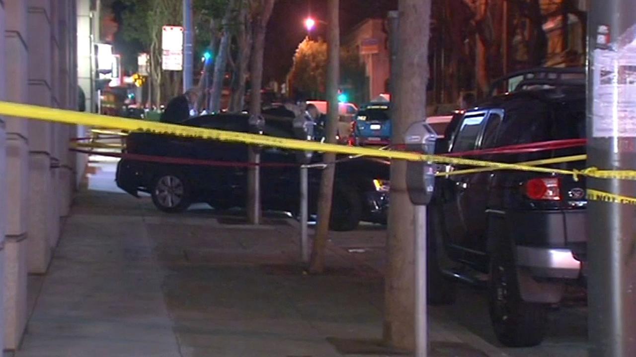 black car on the sidewalk on Pine Street