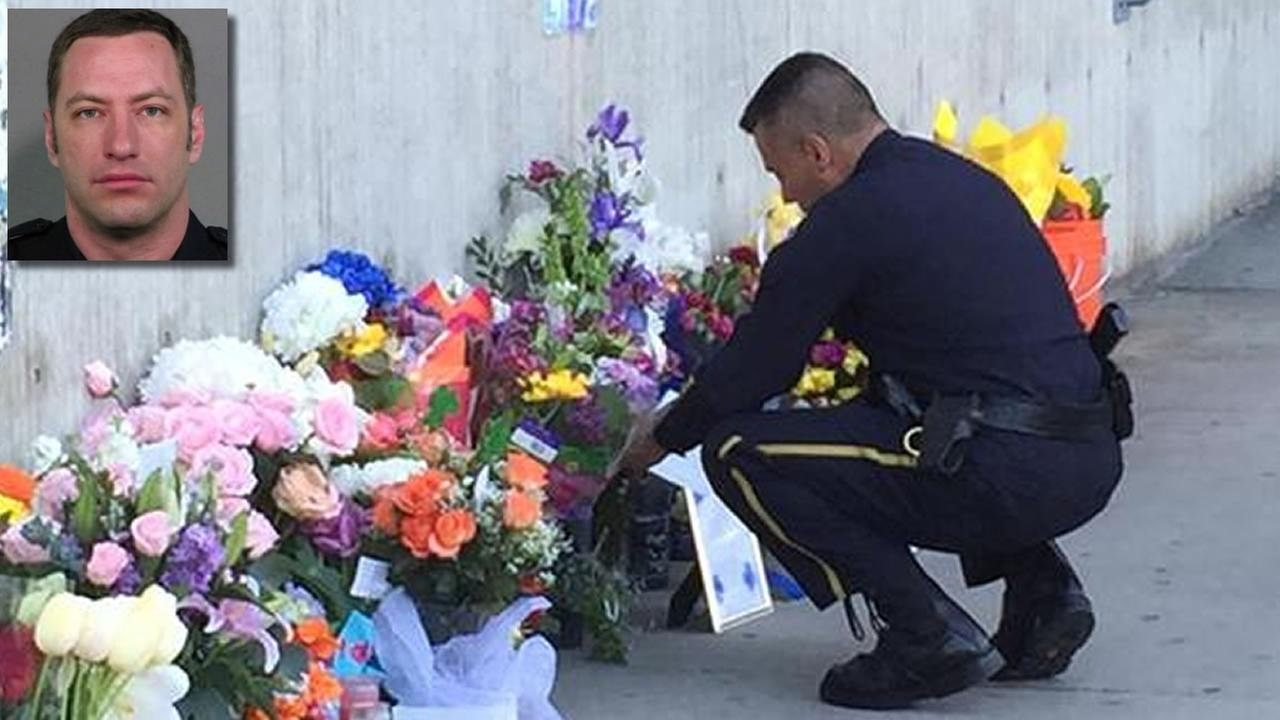 Chief Larry Esquivel kneels down to take a closer look at the memorial