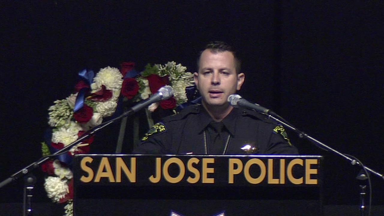 Menlo Park Police Officer David Solis speaks at the memorial for San Jose Police Officer Michael Johnson.