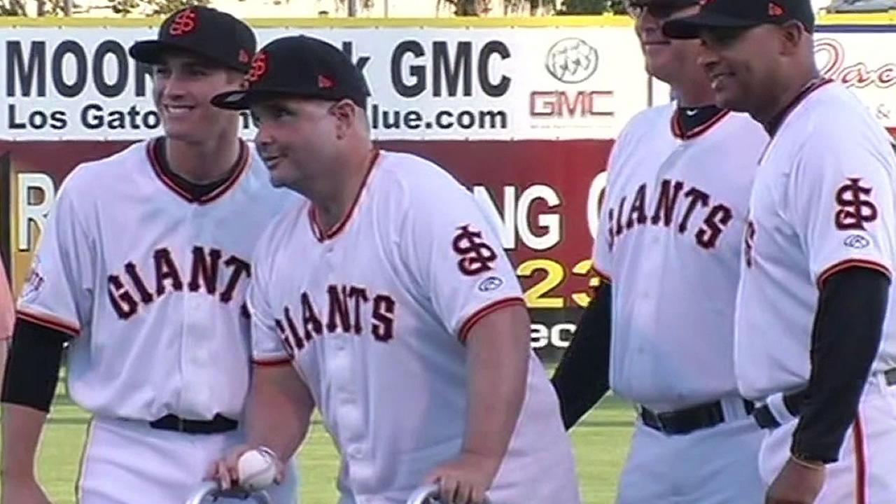 Bryan Stow stands with San Jose Giants players