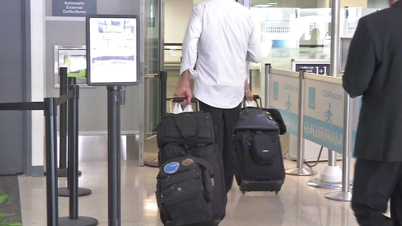 airport employee walks through a side entrance