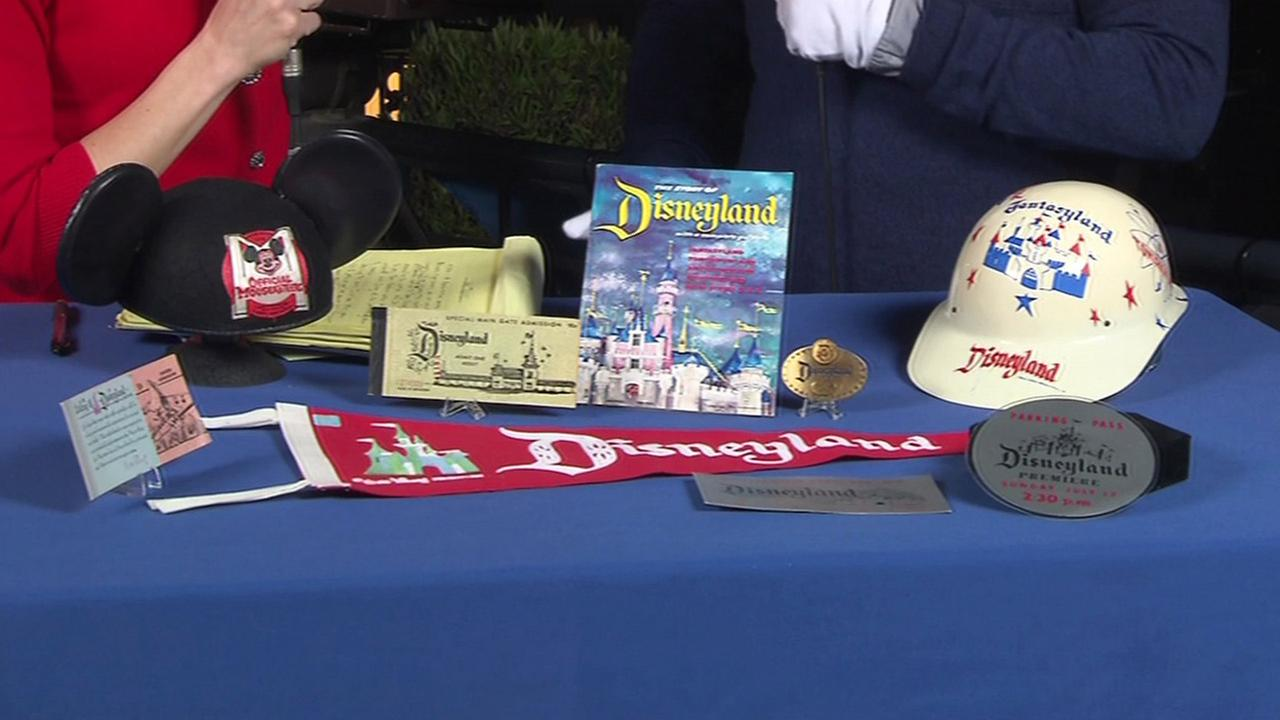 A Disneyland archivist shows off some valuable collectables for the Diamond Celebration.