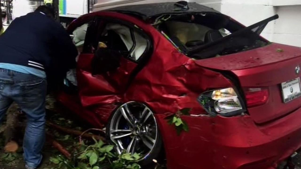 San Francisco police arrested a suspect accused of stealing a BMW from a dealership and smashing it through the showroom window Monday, June 1, 2015.