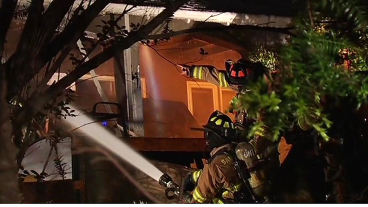 Firefighters battled a two-alarm house fire in the Santa Clara community of Monte Sereno Tuesday morning