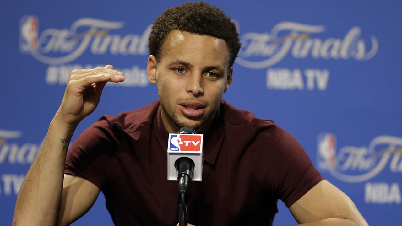 Warriors guard Stephen Curry (30) answers a question during a press conference following Game 4 of basketballs NBA Finals in Cleveland, early Friday, June 12, 2015.