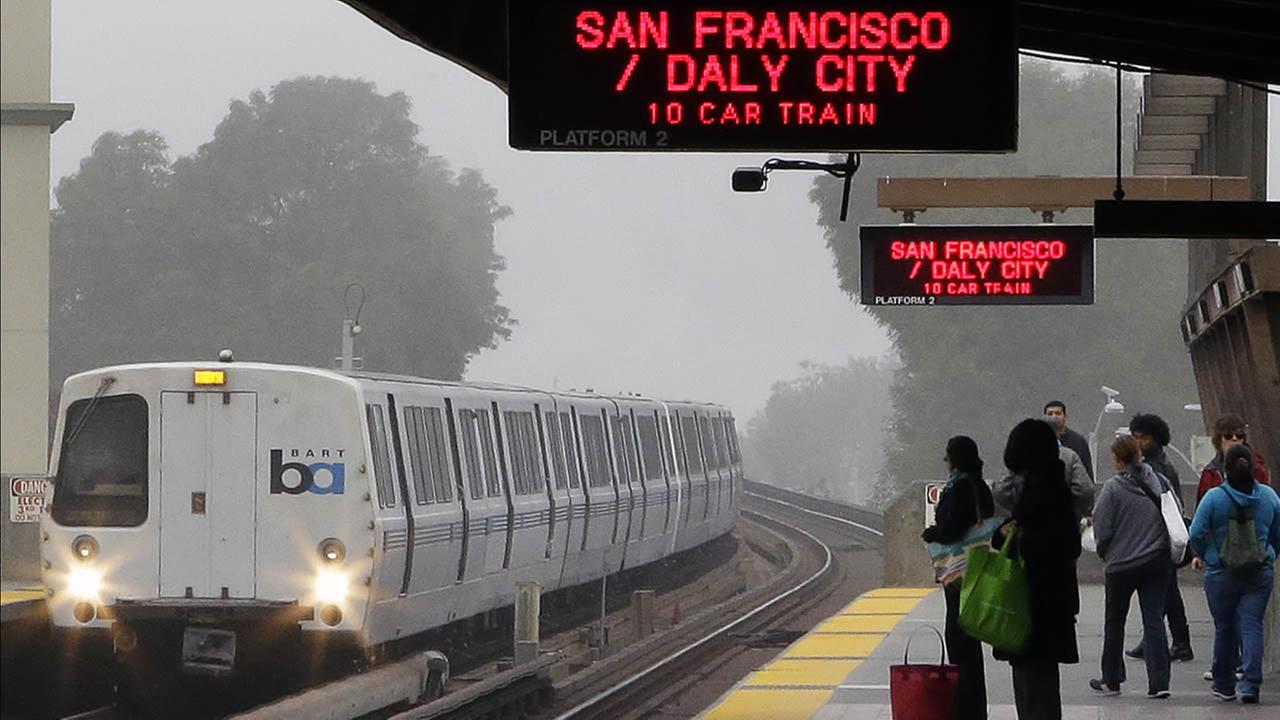 FILE - In this Oct. 22, 2013, file photo, Bay Area Rapid Transit (BART) passengers wait for a train in Oakland, Calif.  (AP Photo/Ben Margot, File)